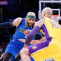 04 April 2014: Dallas Mavericks guard Vince Carter (25) drives past Los Angeles Lakers center Robert Sacre (50) and Los Angeles Lakers forward Wesley Johnson (11) during the Dallas Mavericks 107-95 victory over the Los Angeles Lakers at the Staples Center, Los Angeles, California, USA.