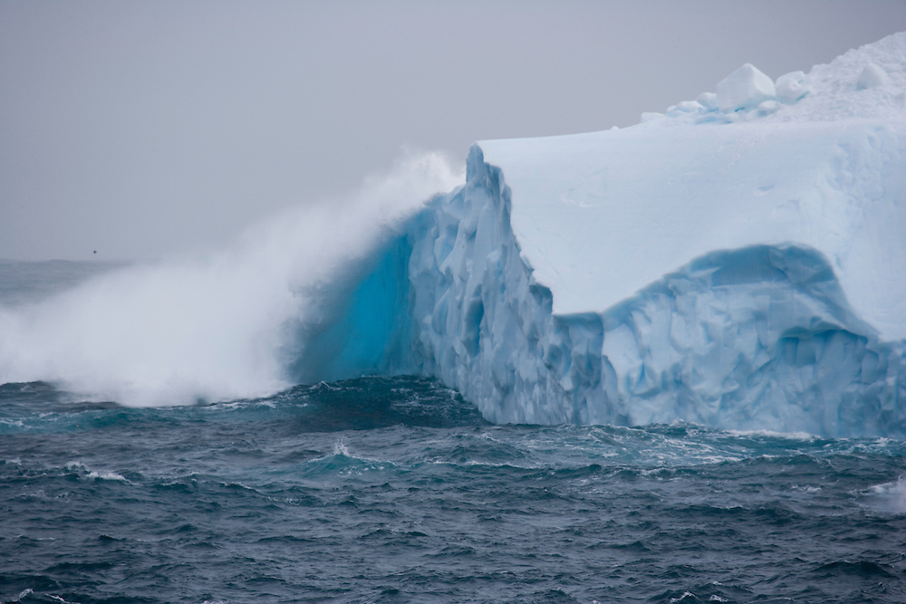 February 6th 2007. Southern Ocean. A wave batters an iceberg in the Ross Sea.