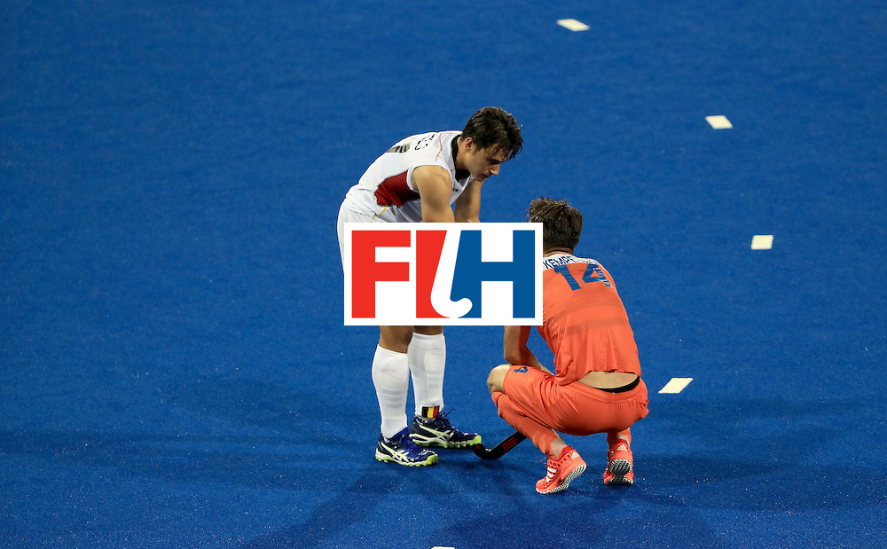 RIO DE JANEIRO, BRAZIL - AUGUST 16:  Thomas Briels #17 of Belgium shakes hands with Robert Kemperman #14 of the Netherlands following a semifinal match on Day 11 of the Rio 2016 Olympic Games at the Olympic Hockey Centre on August 16, 2016 in Rio de Janeiro, Brazil. Belgium won the match 3-1. (Photo by Sam Greenwood/Getty Images)