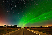 Northern lights or aurora borealis  and road<br /> Birds Hill Provincial Park<br /> Manitoba<br /> Canada