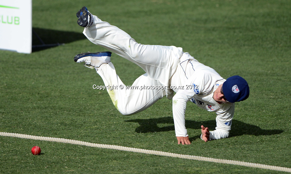 Auckland fielder Craig Cachopa saves a boundary. Plunket Shield Cricket, Auckland Aces v Wellington Firebirds at Eden Park Outer Oval. Auckland on Monday 26 November 2012. Photo: Andrew Cornaga/Photosport.co.nz