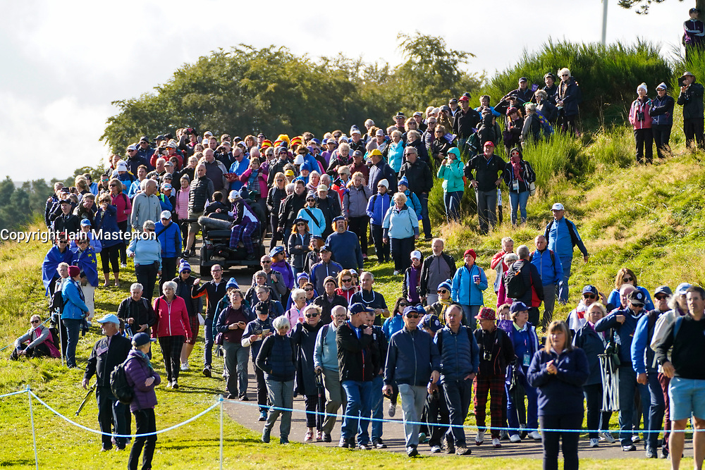 Solheim Cup 2019 at Centenary Course at Gleneagles in Scotland, UK. Large group of spectators makes way along the 9th fairway during the Friday Morning Foursomes.