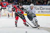 KELOWNA, CANADA - DECEMBER 7: Lucas Johansen #7 of the Kelowna Rockets stick checks Donovan Neuls #19 of the Seattle Thunderbirds as he passes the puck during first period on December 7, 2016 at Prospera Place in Kelowna, British Columbia, Canada.  (Photo by Marissa Baecker/Shoot the Breeze)  *** Local Caption ***