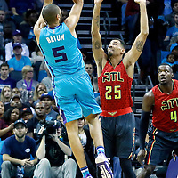 01 November 2015: Charlotte Hornets forward Nicolas Batum (5) takes a jump shot over Atlanta Hawks guard Thabo Sefolosha (25) and Atlanta Hawks forward Paul Millsap (4) during the Atlanta Hawks 94-92 victory over the Charlotte Hornets, at the Time Warner Cable Arena, in Charlotte, North Carolina, USA.