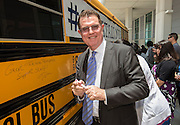 Houston ISD Superintendent Dr. Terry Grier smiles after writing a message on a bus during the Summer Leadership Institute at Reliant Center, June 18, 2013.