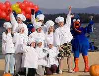 The crew from T Bones/C J's gets pumped up before they take the plunge into Lake Winnipesaukee for the 4th annual Turkey Plunge sponsored by the Salvation Army Laconia Corps on Saturday at Weirs Beach.  (Karen Bobotas/for the Laconia Daily Sun)