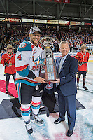 KELOWNA, CANADA - MAY 13: WHL Commission Ron Robison presents Kelowna Rockets Captain Madison Bowey with the WHL Championship Trophy on May 13, 2015 during game 4 of the WHL final series at Prospera Place in Kelowna, British Columbia, Canada.  (Photo by Marissa Baecker/Shoot the Breeze)  *** Local Caption *** Madison Bowey; Ron Robison;