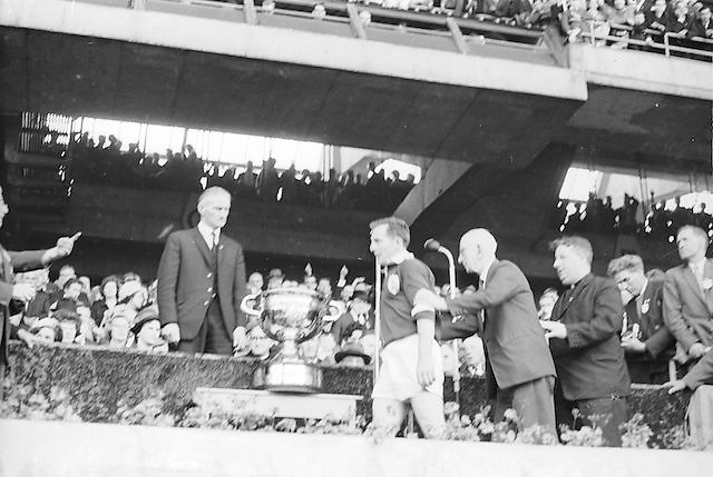 Galway captain about to receive the Sam Maguire cup after their win during the All Ireland Senior Gaelic Football Championship Final, Kerry vs Galway in Croke Park on the 27th September 1964. Galway 0-15 Kerry 0-10.
