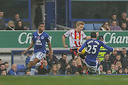 Everton defender Ramiro Funes Mori tackles Sunderland midfielder Duncan Watmore during the Barclays Premier League match between Everton and Sunderland at Goodison Park, Liverpool, England on 1 November 2015. Photo by Simon Davies.
