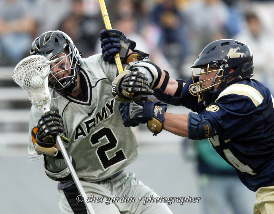 Army's Jeremy Boltus, #2 left, is checked hard by Navy's Geoff Leone, #34 right, during the Annual All-Star game in Michie Stadium at the United States Military Academy, West Point, NY on Saturday, April 12, 2008. Army defeated Navy 9 - 6.  © CHET GORDON/Times Herald-Record