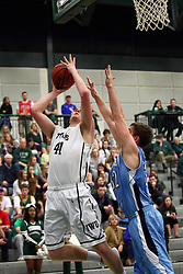 20 February 2016: Trevor Seibring(41) defended by Kenny Payonk during an NCAA men's division 3 CCIW basketball game between the Elmhurst Bluejays and the Illinois Wesleyan Titans in Shirk Center, Bloomington IL
