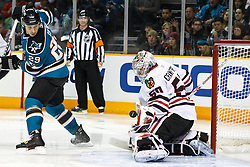 December 11, 2010; San Jose, CA, USA;  Chicago Blackhawks goalie Corey Crawford (50) saves a shot in front of San Jose Sharks right wing Ryane Clowe (29) during the second period at HP Pavilion. San Jose defeated Chicago 2-1 in overtime. Mandatory Credit: Jason O. Watson / US PRESSWIRE