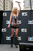 Contestant Shawna Owens competes during the Season 2 IFC 'Hottest Rocker Mom Contest' finale presentation on the Madison Square Park Traffic Island in New York City, USA on June 3, 2009.