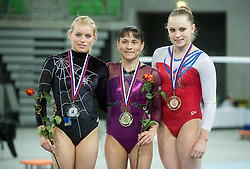 04-04-2015 SLO: World Challenge Cup Gymnastics, Ljubljana<br /> Second placed Teja Belak of Slovenia, winner Oksana Chusovitina of Uzbekistan and third placed Noel van Klaveren of Netherlands at medal ceremony after they competed in the Vault during Final of Artistic Gymnastics World Challenge Cup Ljubljana, on April 4, 2015 in Arena Stozice, Ljubljana, Slovenia. Photo by Vid Ponikvar / Sportida