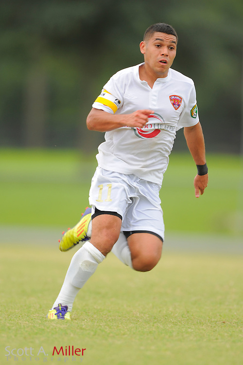 Orlando City midfielder Jonathan Mendoza (11) City's win 4-1 over the Austin Aztex in the PDL Southern Conference Championships final at Trinity Catholic High Schooll on July 22, 2012 in Ocala, Florida. ..©2012 Scott A. Miller