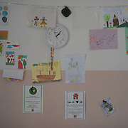 Children's drawings on a wall in the kitchen of Villa Artemis, a shelter for 30 refugee women and their children in the grounds of Leros Hospital. <br />