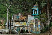 Hindu roadside shrine at Loolacendara.<br /> Roadside shrine on way to Jame's Taylor tea estate. 2006