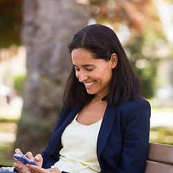Stock Photo of Woman using Mobile Phone (Model Released)