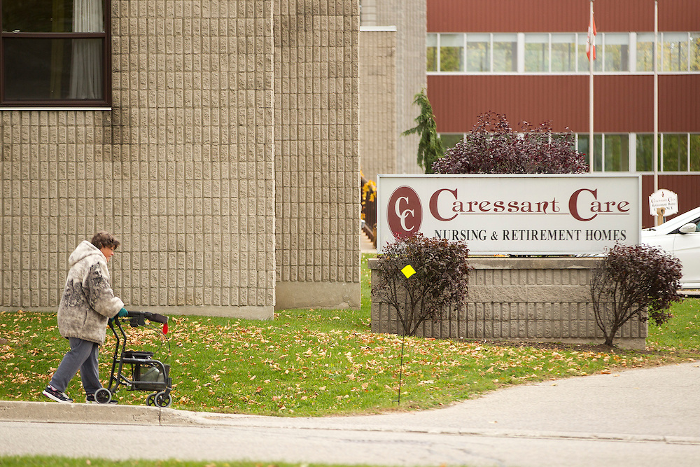 Woodstock, Ontario ---2016-10-25--- A woman walks near the Caressant Care Nursing home in Woodstock, Ontario October 25, 2016 where 7 elderly patients were allegedly murdered by Elizabeth Wettlaufer, a former nurse at the facility. <br /> GEOFF ROBINS The Globe and Mail