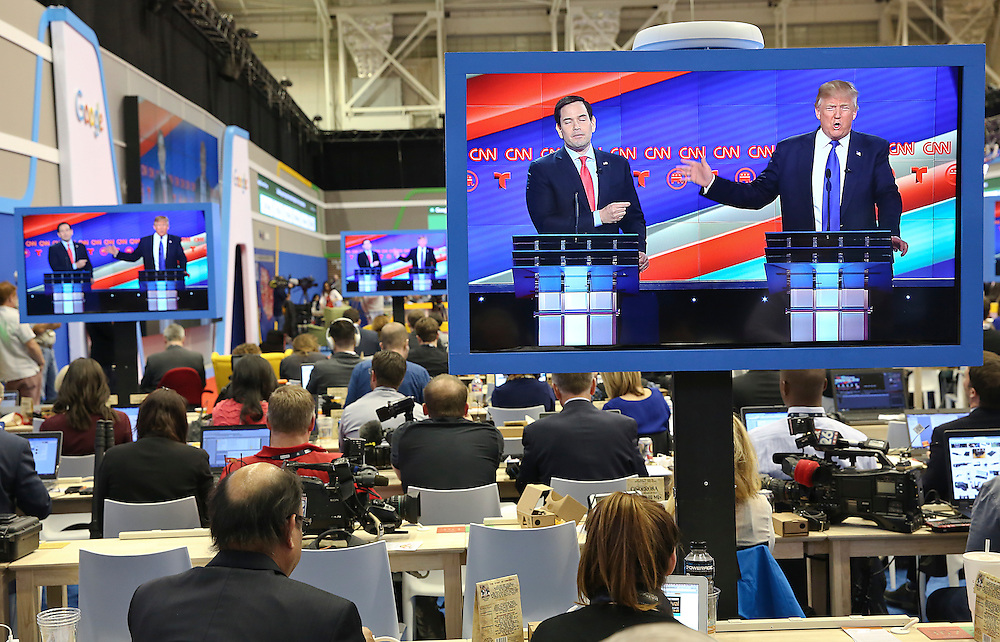 US Republican Presidential Candidates from left to right,  Marco Rubio and  Donald Trump are seen on television in the CNN filing room during the Republican Presidential Debate at the University of Houston in Houston, Texas on February 25, 2016.