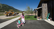 PRICE CHAMBERS / NEWS&amp;GUIDE<br /> Lisa looks after her daughter Sophi, 3, in the driveway of their new home in Teton Village.