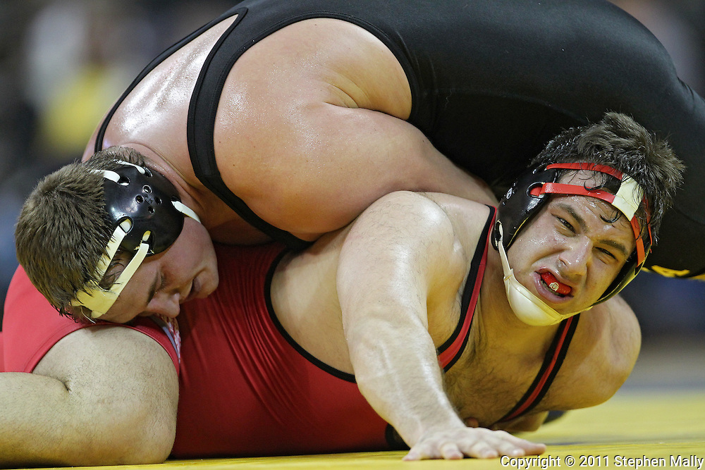 January 22 2010: Iowa's Blake Rasing works on Ohio State's Zach Stolarsky during the heavyweight bout an NCAA wrestling dual at Carver-Hawkeye Arena in Iowa City, Iowa on January 22, 2010. Rasing defeated Stolarsky in a major decision 12-1 Iowa defeated Ohio State 33-3..