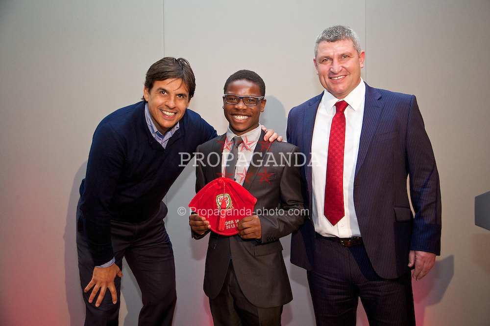 CHEPSTOW, WALES - Saturday, May 24, 2014: Nyasha Mwamuka is presented with his Wales Under-16's cap by Senior mens' team manager Chris Coleman and coach Osian Roberts at the St. Pierre Marriott Hotel & Country Club. (Pic by David Rawcliffe/Propaganda)