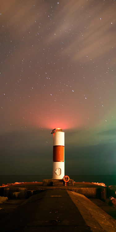 Clouds rush by during a Northern Lights show over Ludington, Michigan