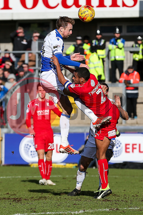 Chris Lines of Bristol Rovers is challenged by Nathan Thompson of Swindon Town - Rogan Thomson/JMP - 28/01/2017 - FOOTBALL - Memorial Stadium - Bristol, England - Bristol Rovers v Swindon Town - Sky Bet League One.