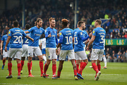 Portsmouth Players Celebrate after Portsmouth Midfielder, Jamal Lowe (10) scores a goal to make it 4-1 during the EFL Sky Bet League 1 match between Portsmouth and Rochdale at Fratton Park, Portsmouth, England on 13 April 2019.
