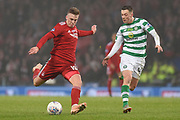 Lewis Ferguson has a shot at goal tracked by Callum McGregor during the Betfred Cup Final between Celtic and Aberdeen at Hampden Park, Glasgow, United Kingdom on 2 December 2018.