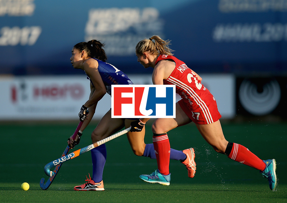 JOHANNESBURG, SOUTH AFRICA - JULY 12: Hazuki Yuda of Japan and Jo Hunter of England battle for possession during day 3 of the FIH Hockey World League Semi Finals Pool A match between Japan and England at Wits University on July 12, 2017 in Johannesburg, South Africa. (Photo by Jan Kruger/Getty Images for FIH)