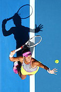 PERTH, AUSTRALIA - JANUARY 06: (EDITORS NOTE: Retransmission with alternate crop.) Heather Watson of Great Britain serves to Andrea Petkovic of Germany in the women's singles match during day six of the 2017 Hopman Cup at Perth Arena on January 6, 2017 in Perth, Australia.  (Photo by Paul Kane/Getty Images)