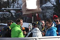 KITZBUHEL AUSTRIA. 22-01-2011. Marco Buechel from ZDF tv inteviews race winner Didier Cuche (SUI) in the finish area of the 71st Hahnenkamm downhill race part of  Audi FIS World Cup races in Kitzbuhel Austria.  Mandatory credit: Mitchell Gunn