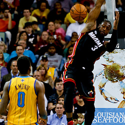Mar 29, 2013; New Orleans, LA, USA; Miami Heat shooting guard Dwyane Wade (3) dunks against the New Orleans Hornets during the second quarter of a game at the New Orleans Arena. Mandatory Credit: Derick E. Hingle-USA TODAY Sports