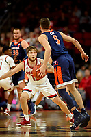Wolfpack guard Braxton Beverly (10) defends against UVA during ACC action in PNC Arena.
