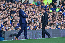 LIVERPOOL, ENGLAND - Sunday, October 4, 2015: Liverpool's manager Brendan Rodgers walks dejectedly off the touchline past Everton's manager Roberto Martinez during his last hame as Liverpool manager during the Premier League match at Goodison Park, the 225th Merseyside Derby. (Pic by Lexie Lin/Propaganda)