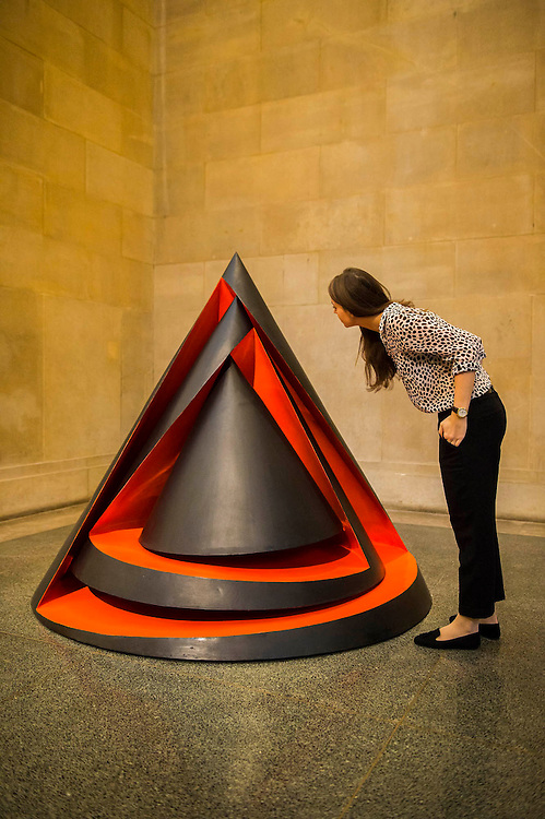 Phillip King , Acrylic and metal. Phillip King exhibition at the Tate Britain, to mark his 80th birthday. The display celebrates King's significant contribution to late 20th century sculpture through six colourful sculptures. These are his key works from the 1960s and include a variety of unusual shapes and forms, demonstrate King's experimentation with abstraction, construction, material and colour. They include iconic sculptures such as Genghis Khan 1963, a conical structure with a pair of antler-like forms and Rosebud 1962, his first coloured sculpture using fibreglass. The works are displayed in the grand surroundings of the Duveen galleries at Tate Britain.