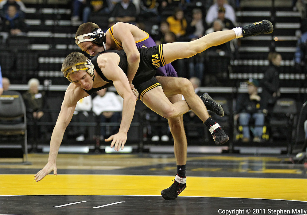 December 8, 2011: Northern Iowa Panthers Cruse Aarhus takes down Iowa Hawkeyes Matt McDonough in the 125 pound bout of the NCAA wrestling dual between the Northern Iowa Panthers and the Iowa Hawkeyes at Carver-Hawkeye Arena in Iowa CIty, Iowa on Thursday, December 8, 2011. McDonough defeated Aarhus 10-1 and Iowa defeated Northern Iowa 38-4.