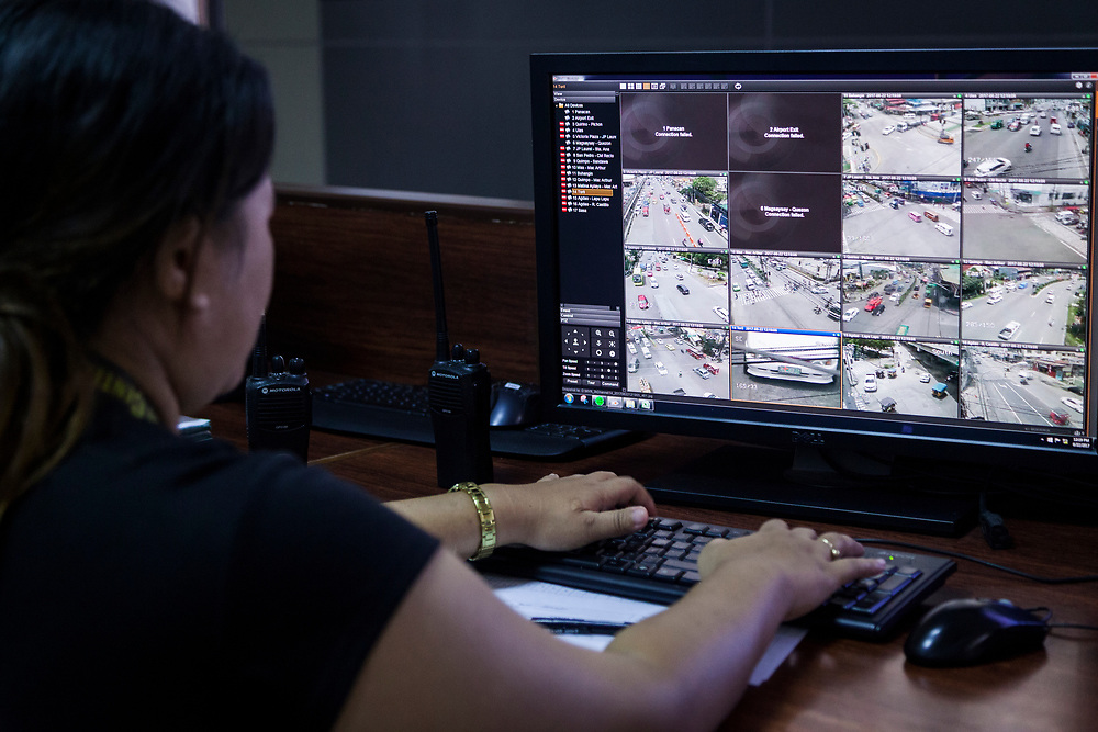 Davao City, Mindanao, Philippines - JUNE 22: Technicians monitor traffic cameras at the Public Safety and Security Command Center.  There are over 175 security and 15 traffic cameras installed in Davao City.  Security in the city is tight since President Duterte implemented a Martial Law for 60 days in Mindanao due to the heavy fighting in Malawi 250km away.
