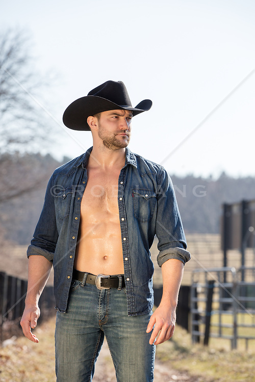 shirtless muscular cowboy on a ranch hot masculine cowboy with an open shirt on a ranch