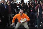 Ashrita Furman catches the most hardboiled eggs by mouth in under one minute at the truTV & GUINNESS WORLD RECORDS event celebrating the premiere of the Guinness World Records Unleashed series, in New York's Times Square, Wednesday, Nov. 6, 2013. (Photo by Diane Bondareff/Invision for Turner Broadcasting Inc/AP Images)