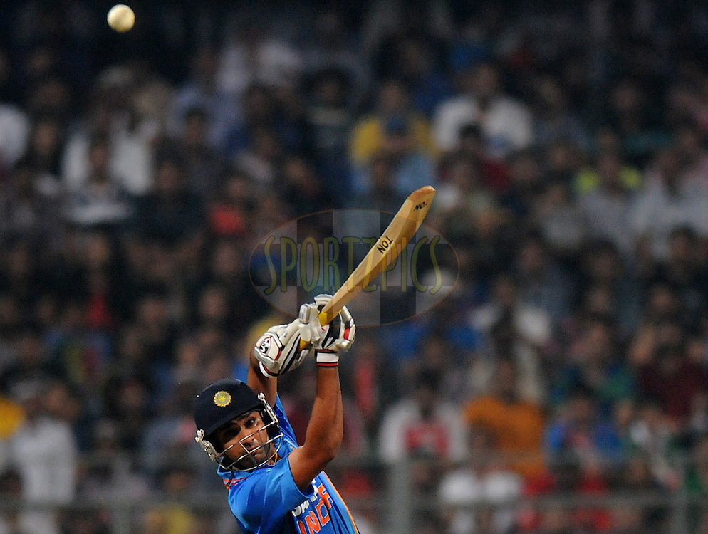 Rohit Sharma of India bats during the 2nd Airtel T20 Match between India and England held at The Wankhede Stadium in Mumbai on the 22nd December 2012..Photo by Pal PIllai/BCCI/SPORTZPICS ..Use of this image is subject to the terms and conditions as outlined by the BCCI. These terms can be found by following this link:..http://www.sportzpics.co.za/image/I0000SoRagM2cIEc