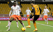 Seko Fofana stands up to Scott Golbourne during the Sky Bet Championship match between Wolverhampton Wanderers and Fulham at Molineux, Wolverhampton, England on 24 February 2015. Photo by Alan Franklin.