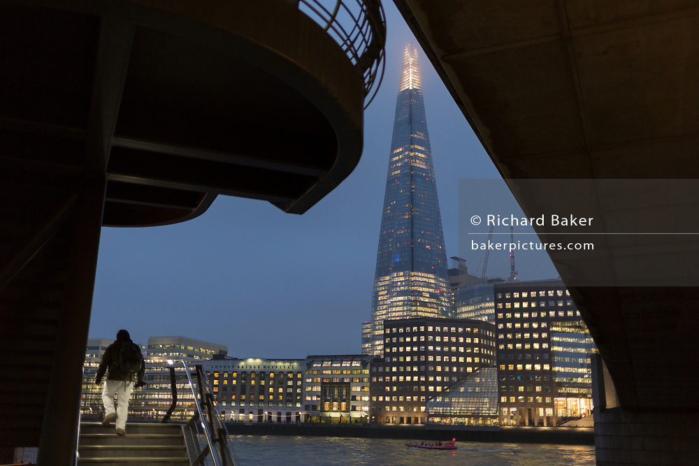 The Shard skyscraper and passers-by beneath London Bridge on a winter's afternoon, on 23rd November 2018, in London, England.