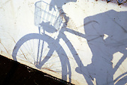 distorted shadow image of person riding bicycle