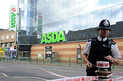 © Licensed to London News Pictures. 10/10/2011. London, UK. A Police cordon outside Asda Superstore on  Broadway, Bexleyheath, South London today (10/10/2011) where a woman was killed in a stabbing. Photo credit : Grant Falvey/LNP