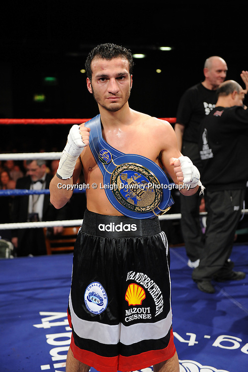 Ermano Fegatilli (pictured with title belt) defeats Stephen Foster Jnr claiming the European Super Featherweight Title after 12 x 3min rounds. Venue: Premier Suite,Reebok Stadium, Bolton,UK. Saturday 26th February 2011. Hatton Promotions. Photo credit © Leigh Dawney.