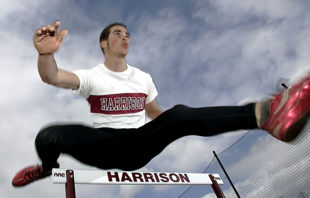Harrison, NY / 2007 - Claudio Delli Carpini from Harrison High School runs through hurdling exercises at the school's track facility. ( Mike Roy / The Journal News )