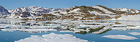 Panorama of sea ice and reflection of Ittoqqortoormiit, in Scoresbysund on Greenland's southeast coast.